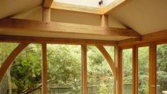 Oak framed extension with direct glazing and lantern.