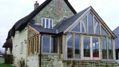 We worked with architect Proctor Watts Cole Rutter on this project, to provide more open plan living space.  We came up with a cost effective glazed oak frame extension, which includes a novel feature brace.  For more images, see our full portfolio.