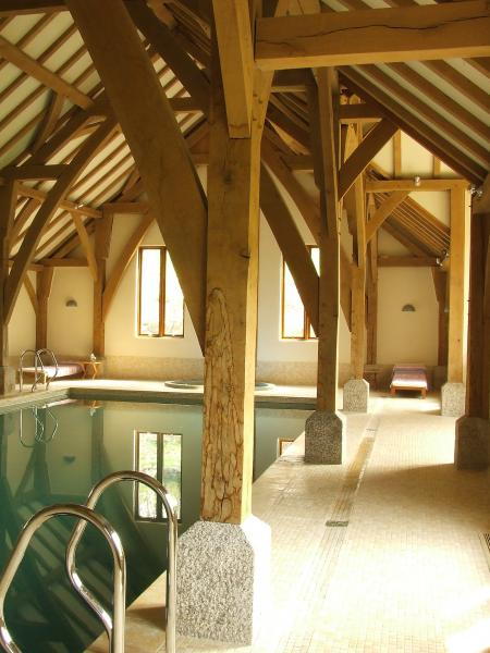 Oak framed pool resting on granite saddle stones.