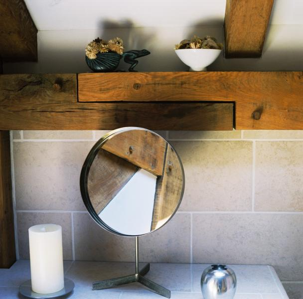 Shaving mirror, candle and oak beams.