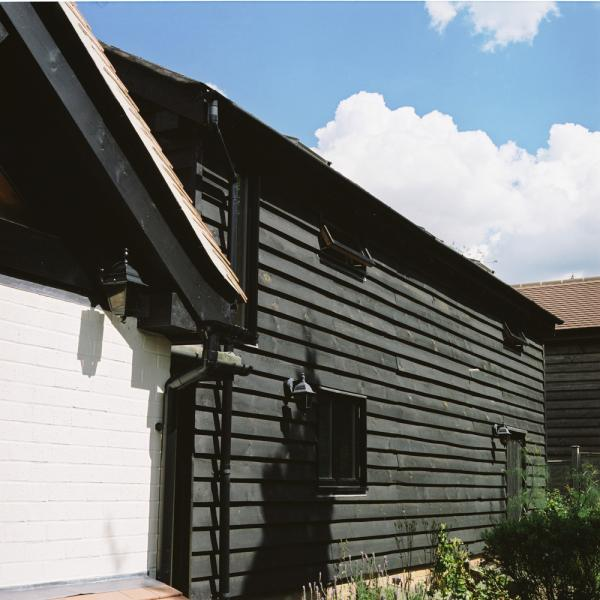 Traditional external weatherboarding on an oak framed barn.